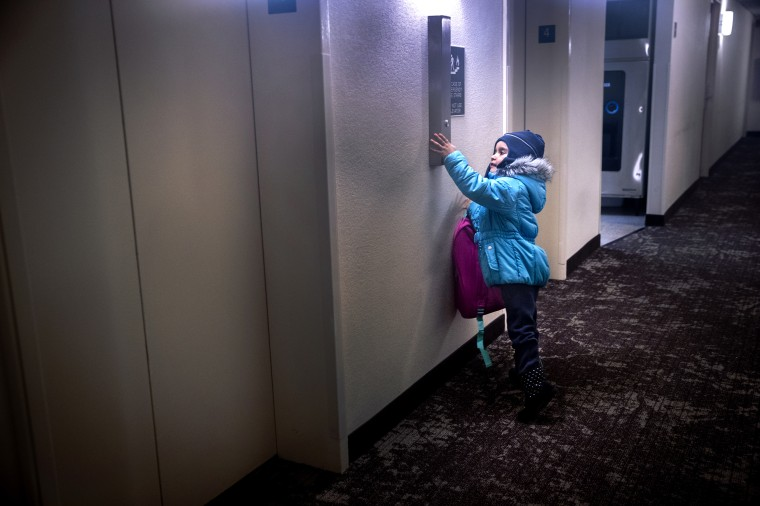 Image: Puerto Rican families escaping Maria build unlikely community in Connecticut hotel