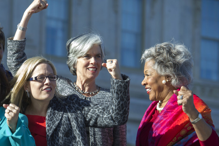 Image: From left, Rep. Kyrsten Sinema, D-Ariz., Rep. Katherine Clark, D-Mass., and Rep. Joyce Beatty, D-Ohio, raise fists
