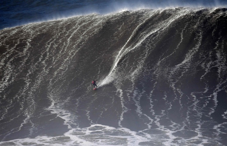 Image: Portuguese big wave surfer Joao Guedes drops a wave during a surf session in Praia do Norte