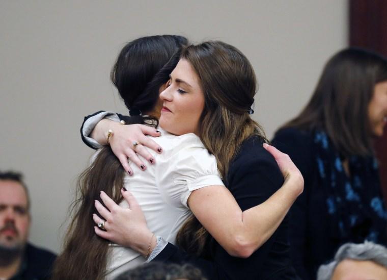 Image: Rachael Denhollander hugs Larissa Boyce