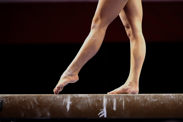 Image: Gymnast's feet on a balance beam
