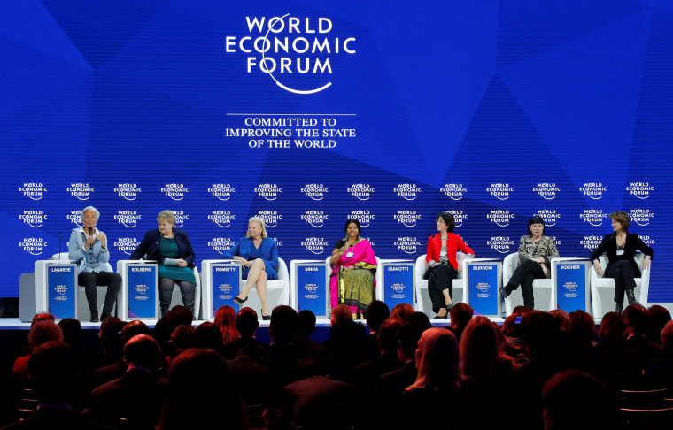 """Image: Attendees are pictured during the session \""""Creating a Shared Future in a Fractured World\"""" during the World Economic Forum (WEF) annual meeting in Davos"""