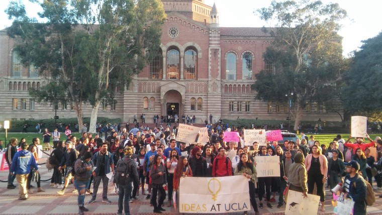 Students and others protest outside a Latino-focused forum featuring California's six candidates for governor held at University of California, Los Angeles on Jan. 25, 2018.