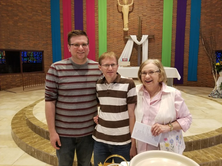 John Freml, left, with his husband and mother.