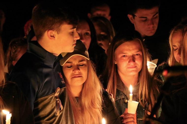 Image: People attend a vigil