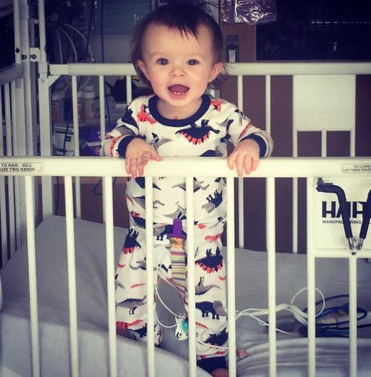 """""""My sweet Jensen Granger, diagnosed with left coronary ostial atresia and mitral valve regurgitation,"""" shared Courtney Nicole. """"He has had two open heart surgeries to replace his valve; his most recent (was) on Christmas Eve 2017 just a week before this picture was taken. He turned 1 on January 10, 2018 and is the bravest, happiest little man around."""""""