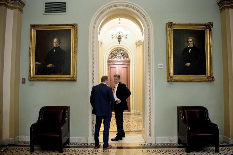 Image: Senator Joe Manchin III (D-WV) stops for a conversation while walking on Capitol Hill Dec. 1, 2017 in Washington, DC.