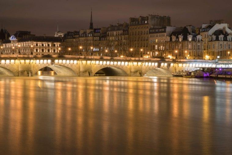 Image: The Seine passes through the Pont Neuf bridge in Paris