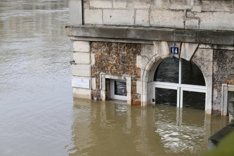 Image: A cafe is partly submerged by the Seine's swollen waters