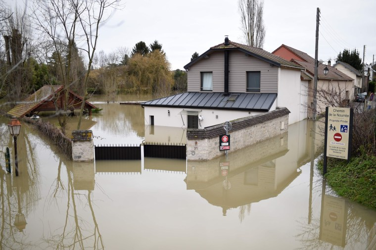 Image: A home is submerged in floodwater from the Seine river