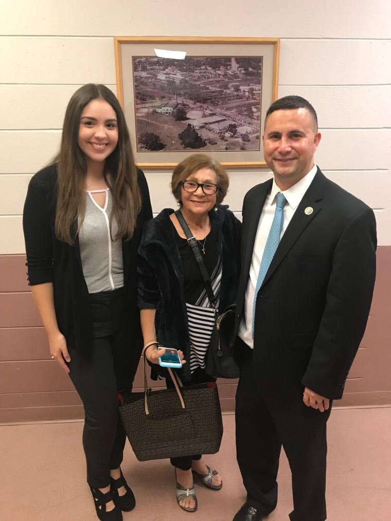 Claudia Baez, her grandmother, and Congressman Darren Soto.