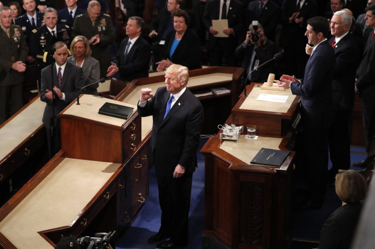 Image: Trump is greeted as he arrives to deliver his State of the Union address in Washington