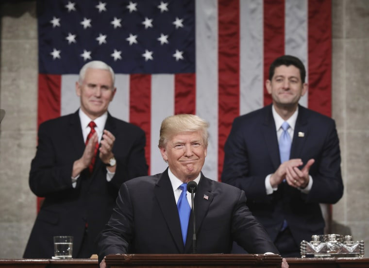 Image: Trump pauses as delivers his first State of the Union address