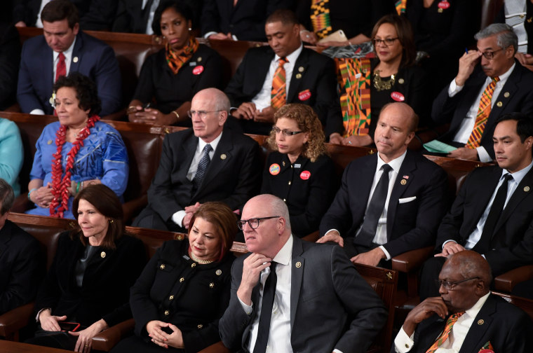 Image: Democratic Senators, House representative, and guests attend the State of the Union