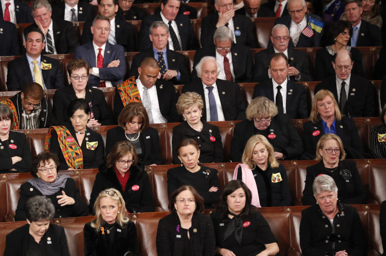Image: Democratic members of congress listen as U.S. President Trump delivers his State of the Union address in Washington