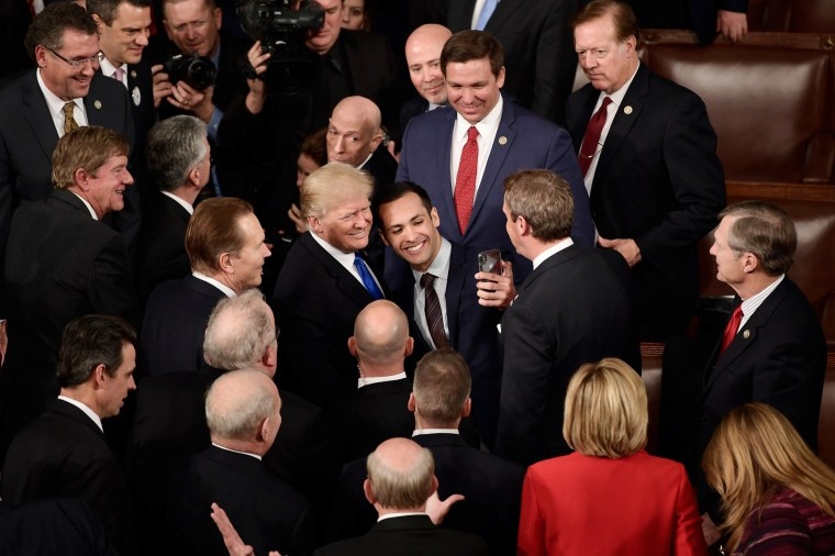 Image: Trump poses for a selfie after delivering the State of the Union address