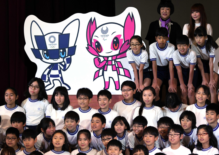 Image: Children poses alongside potential Tokyo 2020 Olympic Games mascots