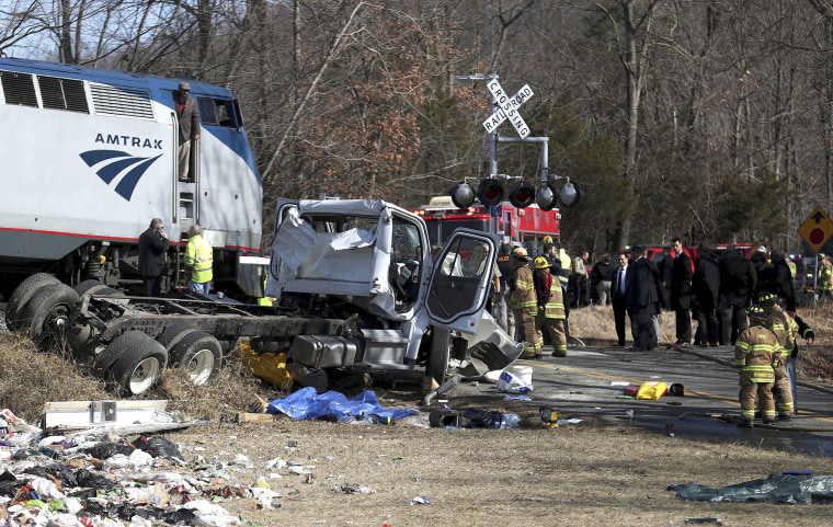 Image: Emergency personnel work at the scene of a train crash in Crozet