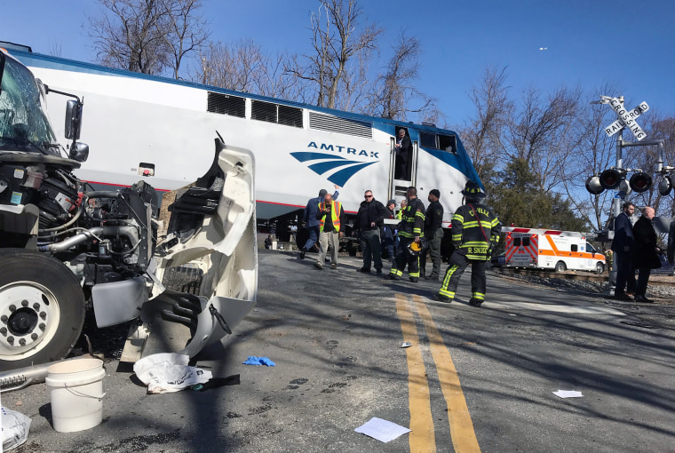 Image: First responders work at the scene where an Amtrak passenger train carrying Republican members of Congress collided with a garbage truck in Crozet, Virginia