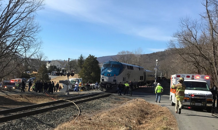 Image: First responders work at the scene where train carrying Republican members of Congress collided with garbage truck in Crozet, Virginia