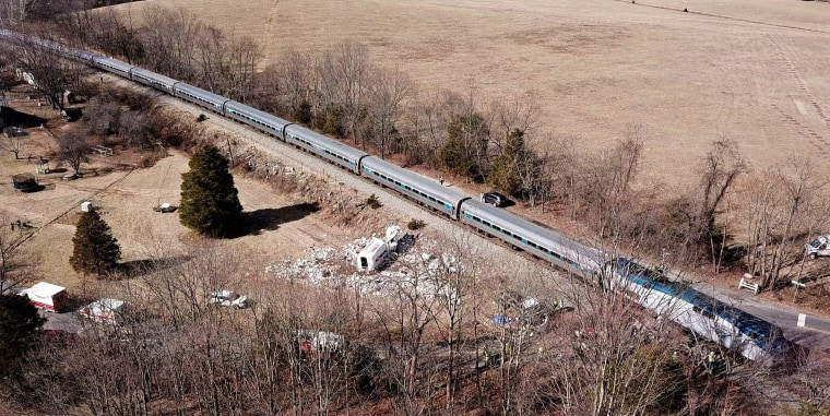 Image: The wreckage of a garbage truck lies beside an Amtrak passenger train after a collision in Crozet