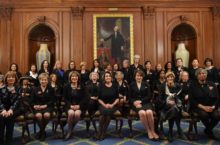 Image: Pelosi and other female Democratic lawmakers pose for a photo ahead of President Donald Trump's State of the Union address
