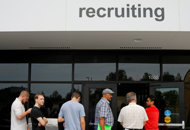 """Image: Job seekers line up to apply during \""""Amazon Jobs Day\"""" at the Amazon.com Fulfillment Center in Fall River"""