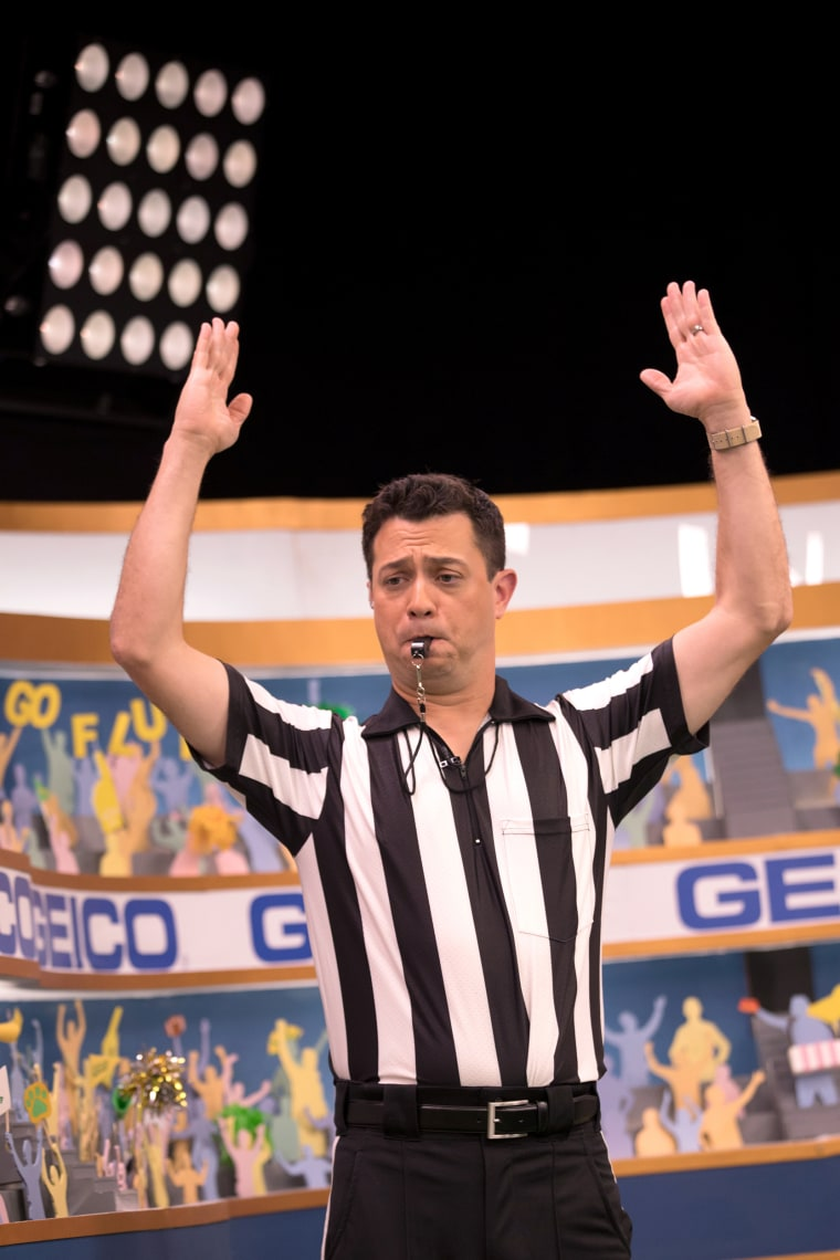 Image: Puppy Bowl Referee Dan Schachner takes the field during Puppy Bowl XIV.