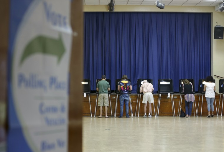 Image: People vote in the general election in Miami Shores