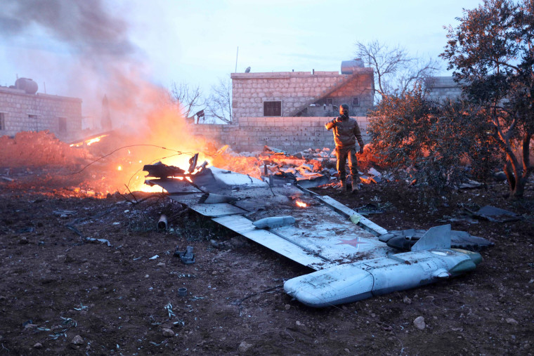 Image: Smoke billows from the site of a downed Sukhoi-25 fighter jet in Syria's northwest province of Idlib on Feb. 3, 2017.