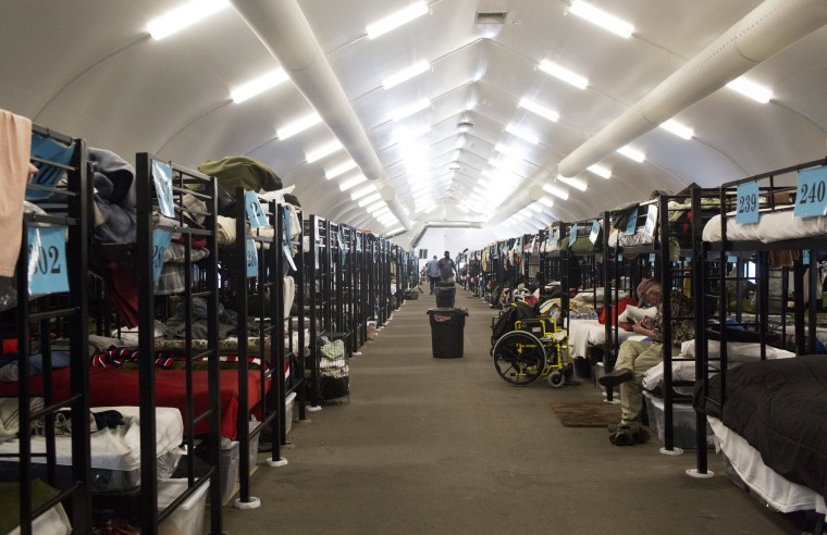 Image: Bunk beds inside a temporary tent operated by Alpha Project