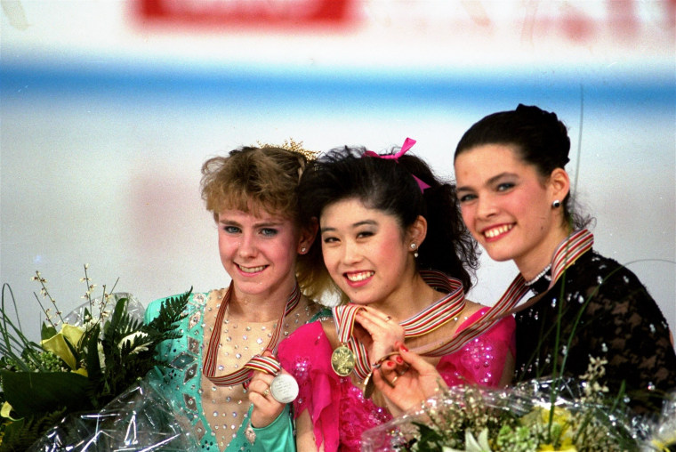 Tonya Harding, Kristi Yamaguchi and Nancy Kerrigan hold up their medals after the World Figure Skating Championships in Munich in 1991.