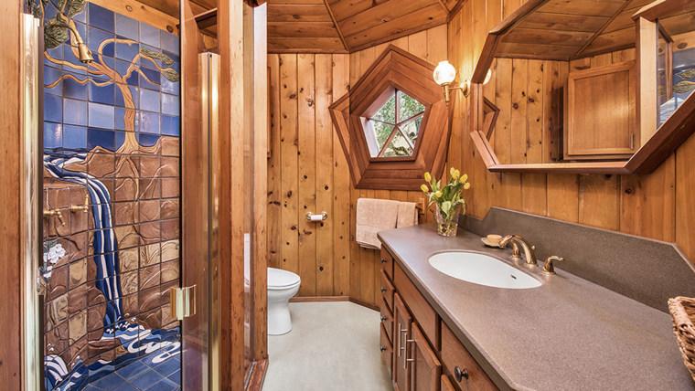 The bathroom features custom tiling.