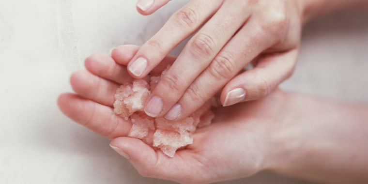 Hands with facial scrub