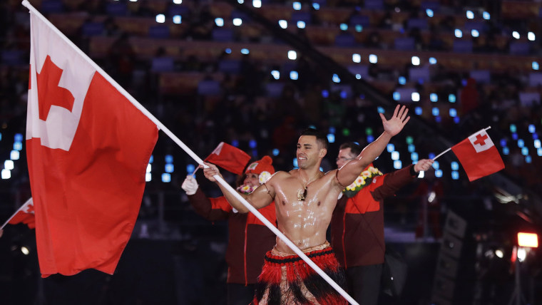 Pita Taufatofua carries the flag of Tonga during the opening ceremony of the 2018 Winter Olympics in Pyeongchang, South Korea, Friday, Feb. 9, 2018.