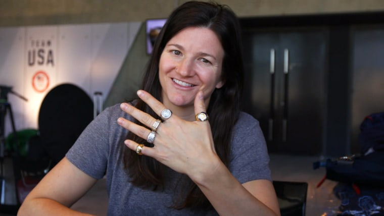 Snowboarder Kelly Clark showed off her Olympic rings for the camera.
