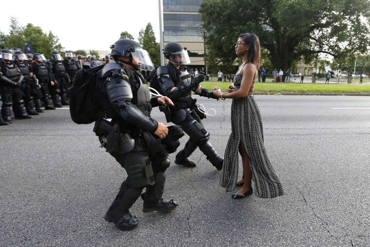 Image: Protestor Ieshia Evans is detained by law enforcement near the headquarters of the Baton Rouge Police Department