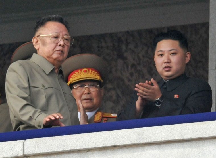 North Korean leader Kim Jong-il (L) walks in front of his youngest son Kim Jong-un (R) as they watch a parade to commemorate the 65th anniversary of the founding of the Workers' Party of Korea in Pyongyang on Oct. 10, 2010.