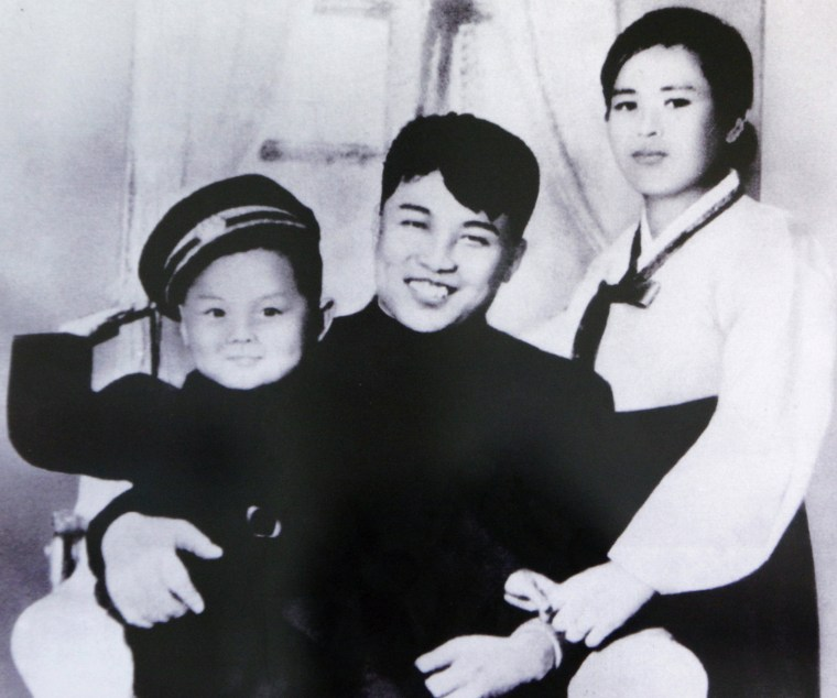 A picture of North Korean founder Kim Il-sung, his first wife Kim Jong-suk and his son Kim Jong-il, is displayed at the Unification Hall at the West Seoul Life Science High School in Seoul on July 17, 2009. North Korean leader Kim Jong-il died on December 17, 2011 state television reported on December 19, 2011. An announcer said he died of physical and mental over-work.