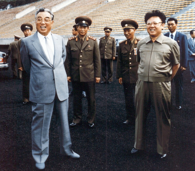 North Korean leader Kim Jong-Il (R) and his father and then-leader, Kim Il-Sung (L), inspecting a football ground in Pyongyang in 1992. 