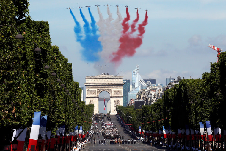 Alpha jets from the French Air Force Patrouille de France fly over the Champs-Elysees avenue during the traditional Bastille Day military parade in Paris, France, July 14, 2017. REUTERS/Gonzalo Fuentes     TPX IMAGES OF THE DAY