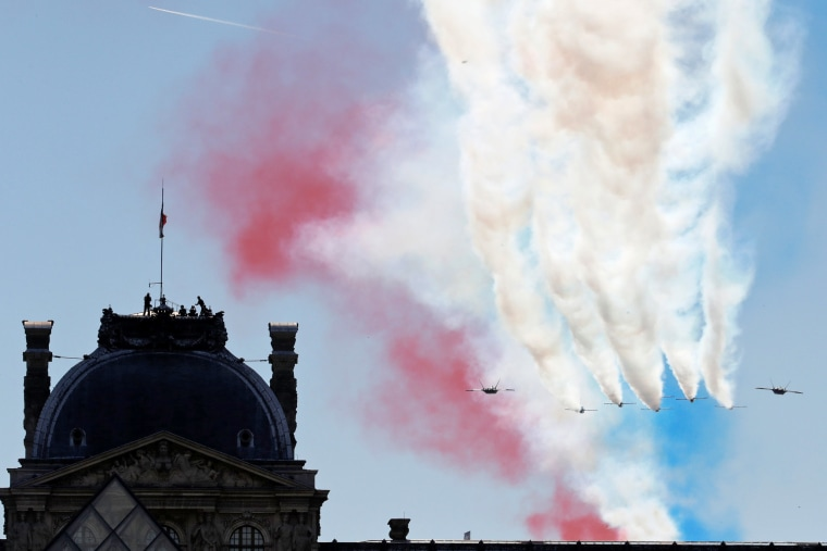 Alpha jets from the French Air Force Patrouille de France fly over the Louvre museum during the traditional Bastille Day military parade in Paris, France, July 14, 2017. REUTERS/Philippe Wojazer