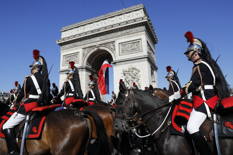 epaselect epa06086309 French Republican guards march during the Bastille Day military parade on the Champs Elysees avenue in Paris, France, 14 July 2017. Bastille Day, the French National Day, is held annually on 14 July to commemorate the storming of the Bastille fortress in 1789.  EPA/ETIENNE LAURENT/POOL / POOL MAXPPP OUT