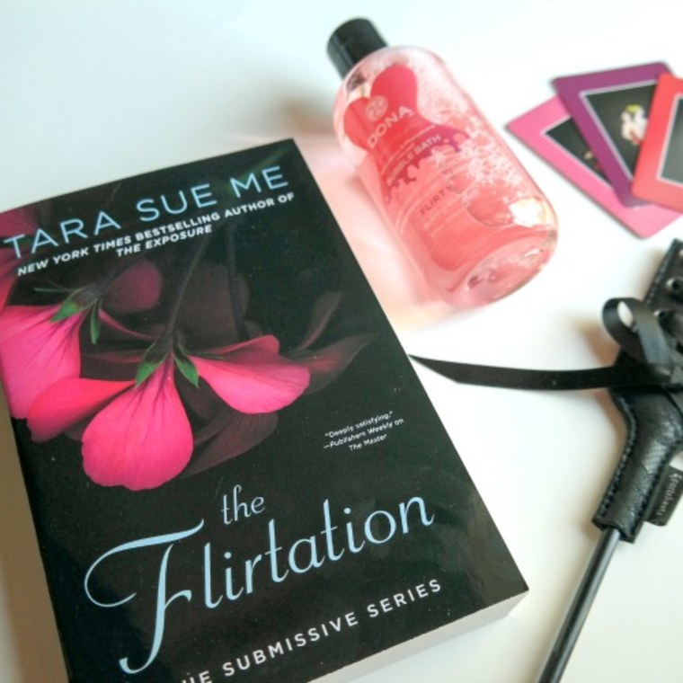 """The """"Hurts So Good"""" Box included the novel """"'The Flirtation' by Tara Sue Me and a crop."""