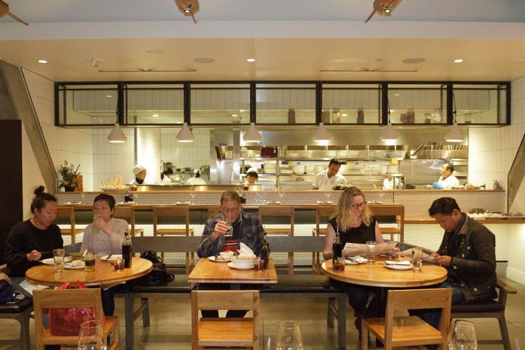 Guests dine in front of the open kitchen at the Market Restaurant, part of China Live.