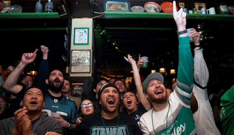 Image: Football fans react as they watch Super Bowl LII between the New England Patriots and the Philadelphia Eagles at McGillin's Olde Ale House in Philadelphia