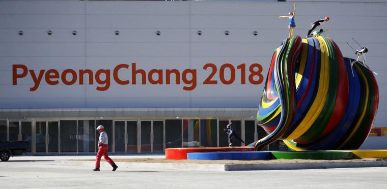 Image: A volunteer walks by the Pyeongchang Olympic Plaza