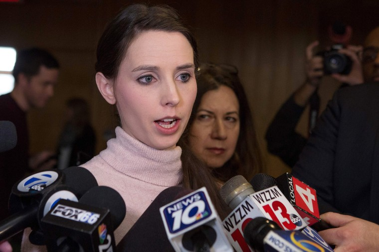 Image: Rachael Denhollander addresses the media following the final phase of sentencing
