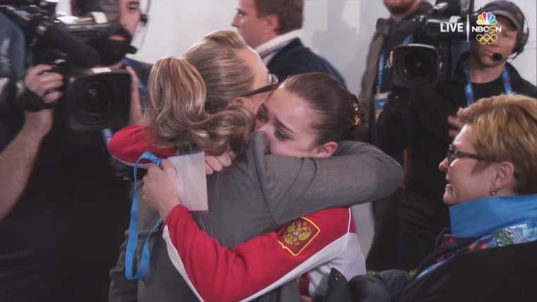 Image: Adelina Sotnikova is embraced by judge Alla Shekhovtsova after winning gold at the 2014 Sochi Winter Olympic Games