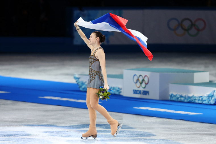 Image: Adelina Sotnikova waves the Russian flag after winning gold